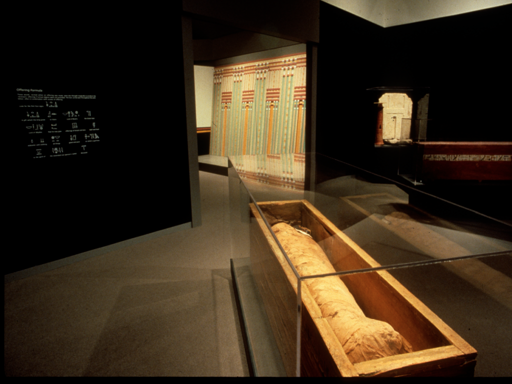 A wooden coffin and a mummy as part of the Mummies and Magic exhibition at the Museum of Fine Arts in Boston