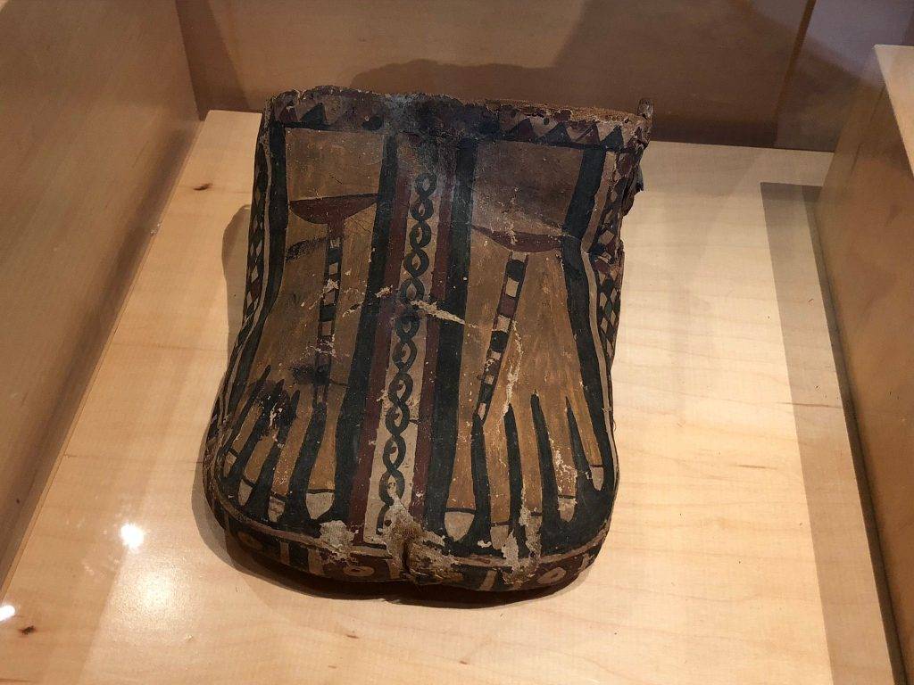 Bottom of a mummy case showing two feet wearing sandals (Obj. No. P84.237 - Provenance unknown)