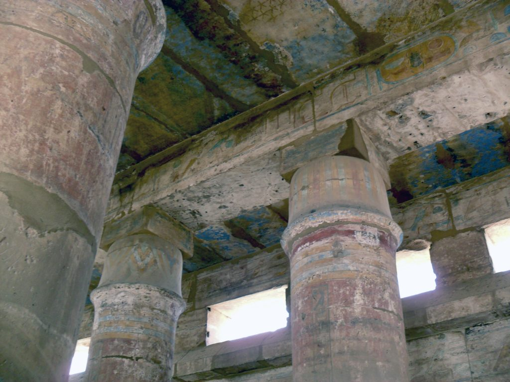 Remnants of blue and red can be seen along the hall with the columns carved as a tent-pole (photo: Nile Scribes)