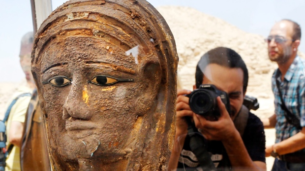 A Saite-Persian Period gilded mummy mask found at Saqqara (Photo: AP Photo/Amr Nabil)