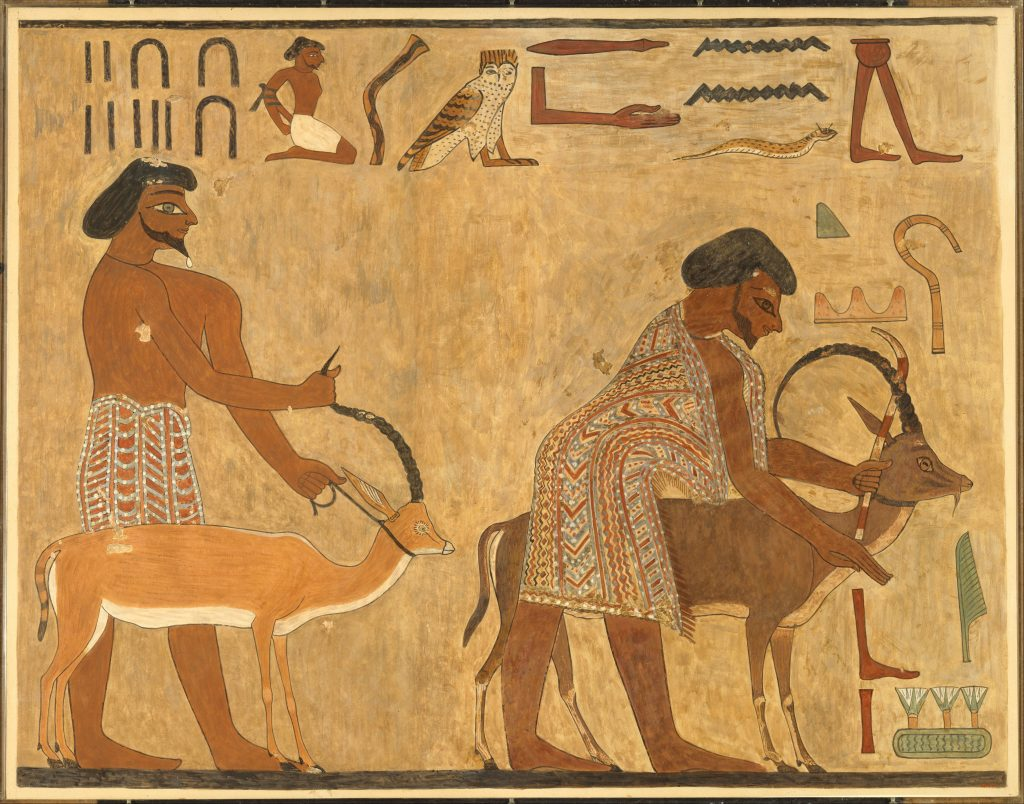 "Facsimile of two ""Asiatics"" from the tomb of Khnumhotep wear the distinctly foreign hairstyles and garments associated with the Asiatics. Note their identification as Aamu in the inscription above them. (photo: Metropolitan Museum of Art 33.8.17)"