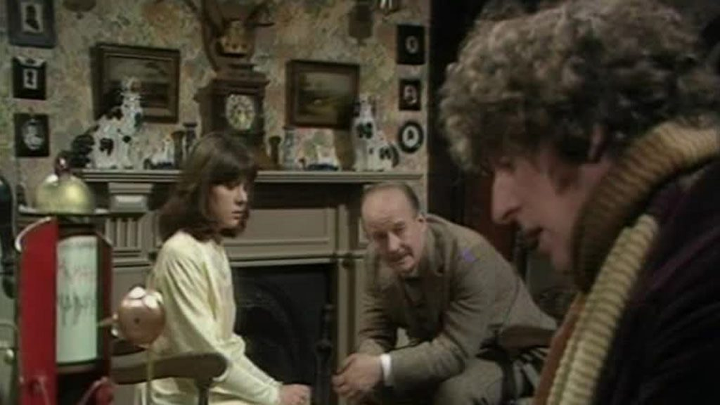 The Doctor and Sarah explain the situation to Laurence Scarman (Michael Sheard) in his intricately recreated lodge (Photo: BBC)