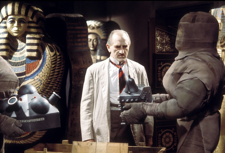 An undead Dr. Scarman overseas the mummy-like robots as they assemble the Osiran war missile (photo: BBC Archives)