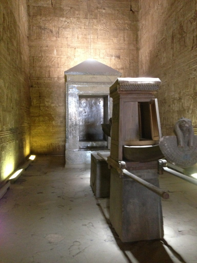 The naos of Nectanebo I in the sanctuary at Edfu (back) and a replica of the divine barque of Horus (fore) (Photo: Nile Scribes)