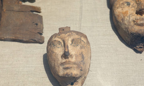 A wooden mask was among the finds from a Middle                      Kingdom tomb at Lahun (Photo: Ahram)
