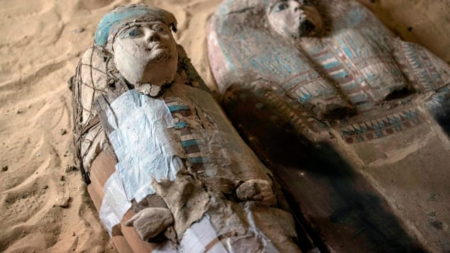 Several discovered wooden coffins feature                      bright colours (Photo: CNN)