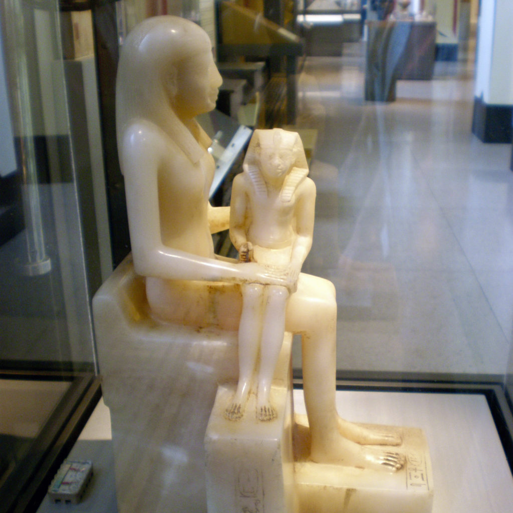 A young Pepy II is seated in the lap of his mother                  Ankh-nes-Mery II (Sixth Dynasty - Brooklyn Museum)                  (Photo: Nile Scribes)